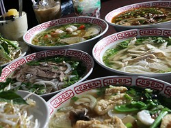 Veggie Tofu Pho, front right, Beef Pho, left, Seafood Pho, back left, Chicken Pho, center right, and Beef Chili Hue Soup, back right - MT PHOTO: ROB WIDDIS