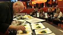 Zazios' executive chef Matt Schellig cooks at the Chef's Table for a group of diners - ROB WIDDIS