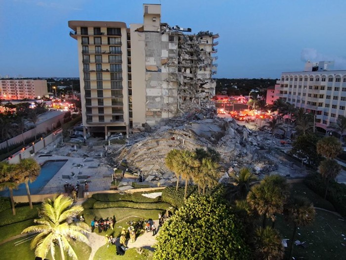 An early-morning view of the devastation from the Champlain Towers condo collapse in Surfside. - PHOTO BY MIAMI-DADE FIRE RESCUE VIA TWITTER