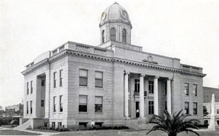 """Erected in 1884 by the Ladies of the Memorial Association of Gadsden County, a Confederate monument in Quincy featured a phalanx atop a four-sided base. On one side of the base appears to be an officer in a dress uniform. On another side it said, """"Sacred to the memory of the Confederate Soldiers from Gadsden County who died for their country."""" - PHOTO BY CHICAGO COMMERCIAL COLORTYPE COMPANY/STATE ARCHIVES OF FLORIDA"""