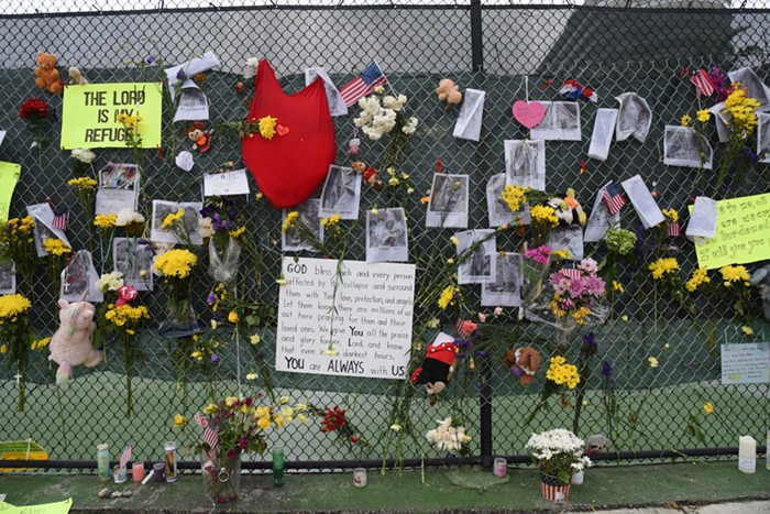 A memorial wall for the people lost at Champlain Towers. - PHOTO BY MICHELE EVE SANDBERG