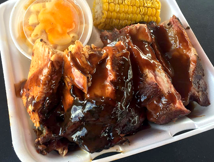 Barbecued ribs and sides at Bo Legs BBQ. - PHOTO COURTESY OF BO LEGS BBQ
