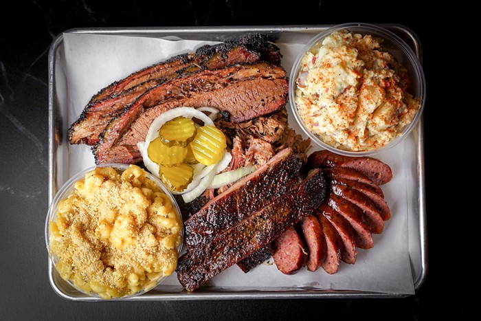 Platter of meats and sides from La Traila. - PHOTO BY ANDREA GRIECO