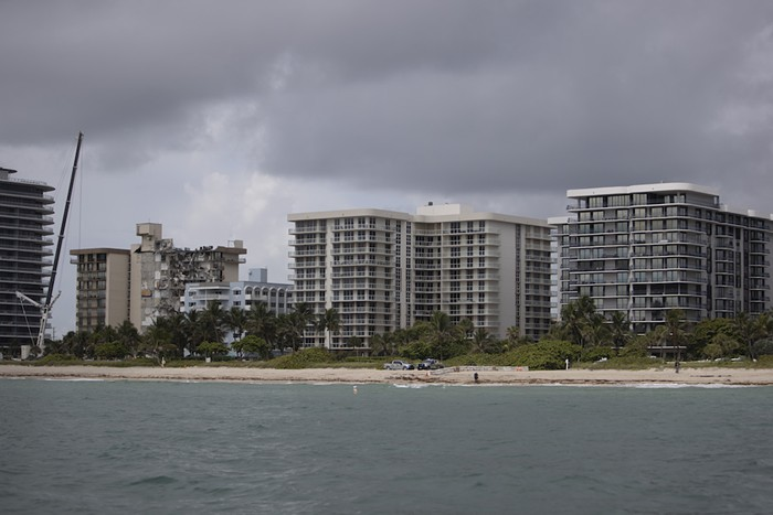 Surfside Mayor Charles Burkett recommended that residents of Champlain Towers North (far right) evacuate - PHOTO BY JOE RAEDLE/GETTY IMAGES