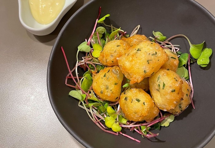 Lur, inside Time Out Market in Miami Beach, prepares Basque-inspired fare including these codfish buñuelos. - PHOTO COURTESY OF LUR