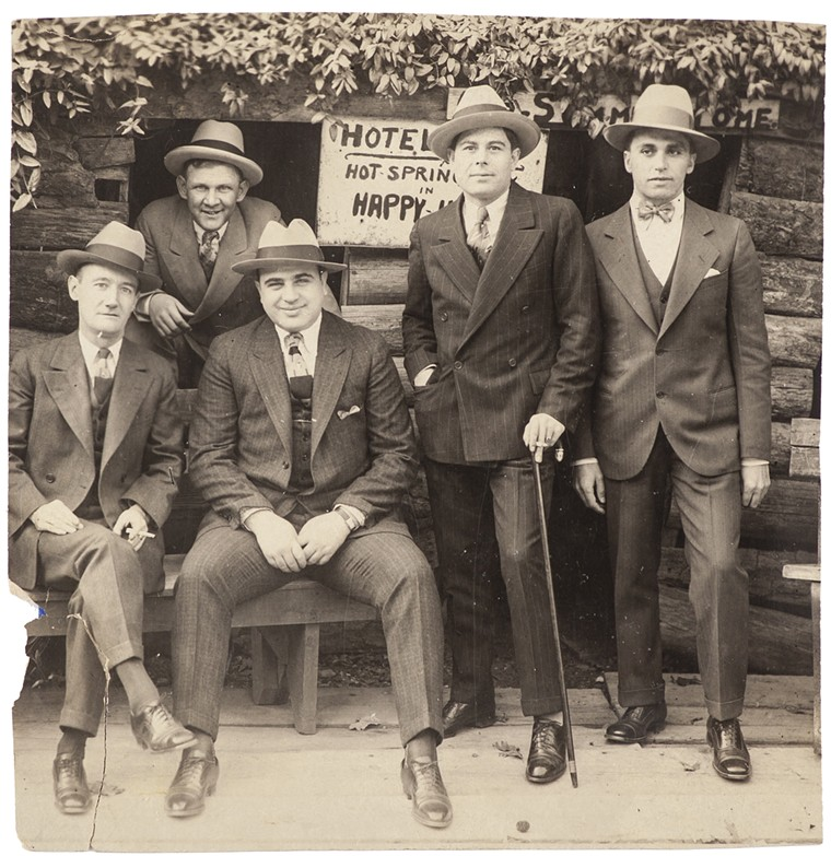 An undated family photo of Al Capone (center) and associates. - PHOTO COURTESY OF SHELDON CARPENTER/WITHERELL'S INC