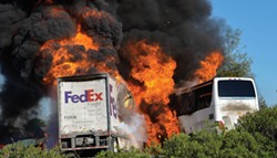 PHOTO BY JEREMY LOCKETT/J. LOCKETT PHOTOGRAPHY - A FedEx truck and the charter bus carrying almost 50 prospective Humboldt State University students burst into flames after an accident on I-5 April 10 that killed 10 people, including both drivers, five high school students and three adult chaperones.