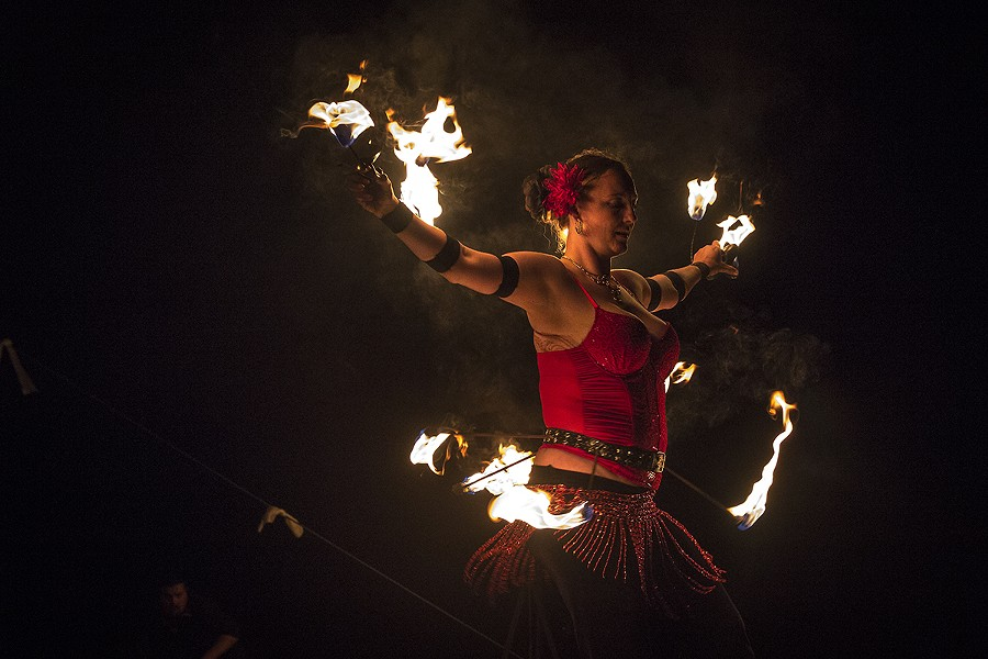 A fire dancer performs a solo act at the Blue Lake Havest Days. - MANUEL J. ORBEGOZO