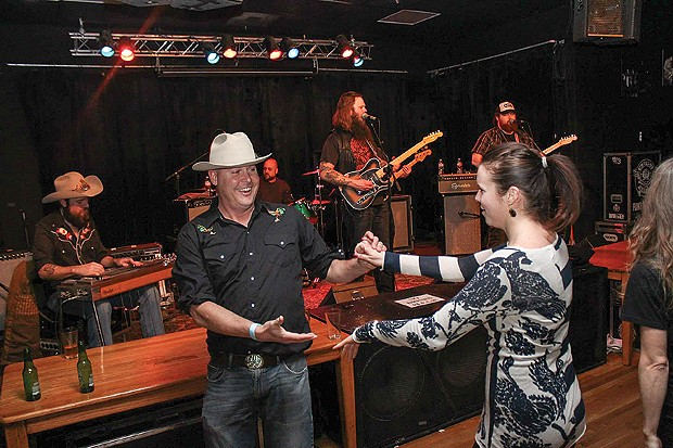 """A good guy in a white hat, """"Peeping"""" Thomas Gai, swings his partner to Whitey Morgan and the 78's at Humboldt Brews. - PHOTO BY BOB DORAN"""