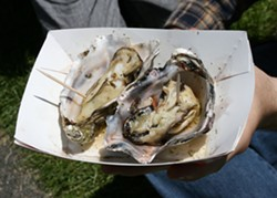PHOTO BY BOB DORAN - a pair of grilled oysters from North Bay Shellfish