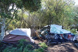 PHOTO BY THADEUS GREENSON - About 100 people were living in some three dozen encampments in the area behind the Bayshore Mall when Eureka police conducted a sweep on April 15, searching for people with active arrest warrants.