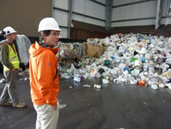 PHOTO BY RYAN BURNS. - ACRC Executive Director Marc Loughmiller approaches the plastic mountain at the nonprofit's Samoa recycling facility.