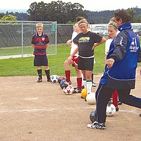 "Soccer Dreams ""Addressing the ball"" the French way  -- a demonstration by Coach Lledo. Photo by Heidi Walters"