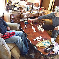 Love Me, I'm a Lamprey After an afternoon of eeling, Jimmy Donahue and Merk Oliver play domino cribbage in Oliver's house on the north bank of the Klamath River at Requa, near the river's mouth. Photo by Heidi Walters