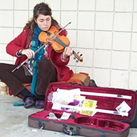 Cold Shoulders Alessa Bakkum was busking for some room money for her and her boyfriend last week in Arcata's Valley West shopping center. She's just traveling and playing her music, she said, before she heads home to Minnesota for the holidays. Photo by Heidi Walters