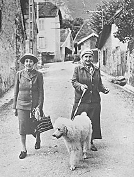 Alice B. Toklas and Gertrude Stein walk their dog in a village in southeastern France. Photo from the collection of University of California, Berkeley's Bancroft Library.