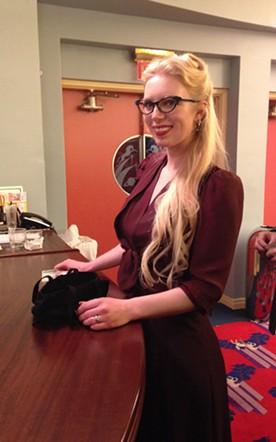 Alyse Laverne is swing-shift swell in cat eye glasses and war-era dress. - JENNIFER FUMIKO CAHILL