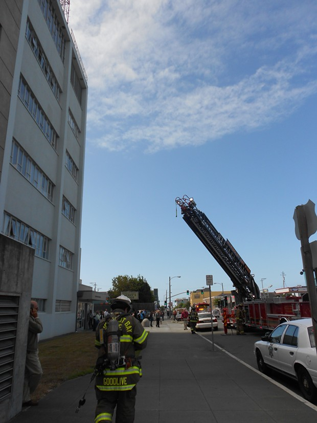 A Humboldt Bay Fire ladder truck extends toward the courthouse roof. - LINDA STANSBERRY