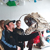 Pollution as Art Artist Jimmie Nord shows Pacific Union School students how his sculpture, Angler Trash, works. Photo by Katherine Almy.