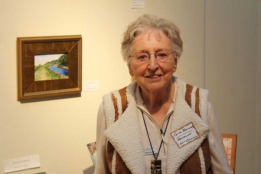 Artist Julia Bednar, a member of the board of the Humboldt Arts Council, celebrated her 80th birthday at a Eureka Chamber of Commerce mixer hosted by the council at Morris Graves Museum of Art on Thursday. - PHOTO BY BOB DORAN.