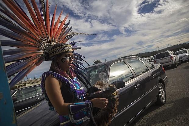 Asucena Carreras burns sage prior to her performance with Tezkatlipoka Aztec Dance & Drum group. - MANUEL J. ORBEGOZO