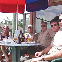 Two If By Sea Austrians Bruno Mennel, Klaus Hatter, Andi Lässer, Richard Hagspiel and Joachim Fink, of the Royal Fly Fishing Club, drink beer at the Café Marina on Woodley Island after a bountiful day of halibut fishing on the Reel Steel. Photo by Heidi Walters