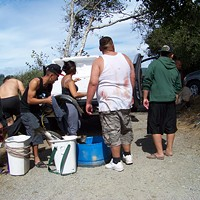 Combat Fishing on the Klamath Back at the car, stowing all that Chinook in coolers. Photo by Heidi Walters