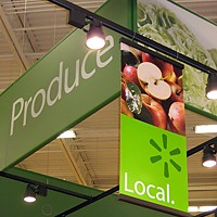 "Here, There and Everywhere Banners in nation-wide grocery store chains proclaim ""Local Produce."""