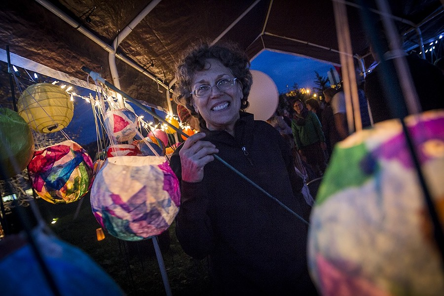 Barbara Reisman picks up a lantern at the Blue Lake Harvest Days community pageant. - MANUEL J. ORBEGOZO