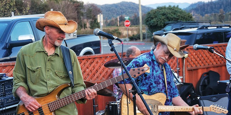 Bassist Ron Sharp and lead guitarist Rick Levin of the cosmic American music band Cadillac Ranch trade licks at a dance concert at Mad River Brewery in Blue Lake on a warm summer Friday evening, Aug. 15.