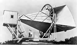 "PHOTO COURTESY OF NASA - Bell Telephone Laboratories' horn antenna in Holmdel, New Jersey, with which Arno Penzias and Robert Wilson (shown in this 1965 photo) first detected the cosmic microwave background, thus providing the first hard evidence for the ""big bang"" paradigm."