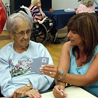 'Immediate Jeopardy' Brenda Flores (right) is one of five family members who make almost daily visits to Mary Machado at St. Luke Healthcare and Rehabilitation in Fortuna.  Photo by Carol Harrison