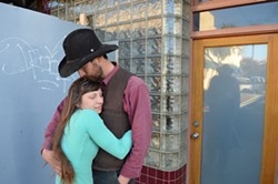 PHOTO BY GRANT SCOTT-GOFORTH - Brett and Julia McFarland outside the Journal office.