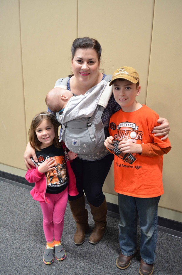 Lara Mikkelsen, with Ben, Emaleigh and Finley, got a sneak peek at the trophies. - SEAS OF ORANGE.