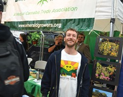 "PHOTO BY GRANT SCOTT-GOFORTH - Casey O'Neill's flower entry didn't make the top 20, but he was all smiles at the Emerald Cup. ""The best growers get the stumbling blocks out of the way of the plant,"" he said."