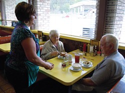 PHOTO BY HEIDI WALTERS - Charlene Hansen Primofiore serving regulars Eleanor and Richard Sweet, of Rio Dell, on a recent Friday at the cafe.