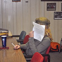 Ferndale Gothic Cindy Olsen, a member of the Humboldt County Fair Association Board of Directors, hides her face from the camera of Ferndale Enterprise editor/publisher Caroline Titus at a Feb. 4 meeting. photo by Drew Hyland