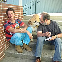 Rekindling Magic Clowntown musical director Jimmy Durchslag (on right) confers with ringmaster Hal Bahr on the back steps of the Garberville Veteran's Hall. Photo by Bob Doran