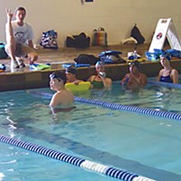 Can't Swim Coach Cameron Mull and the Humboldt Swim Club at the Arcata Pool. Photo by Heidi Walters.