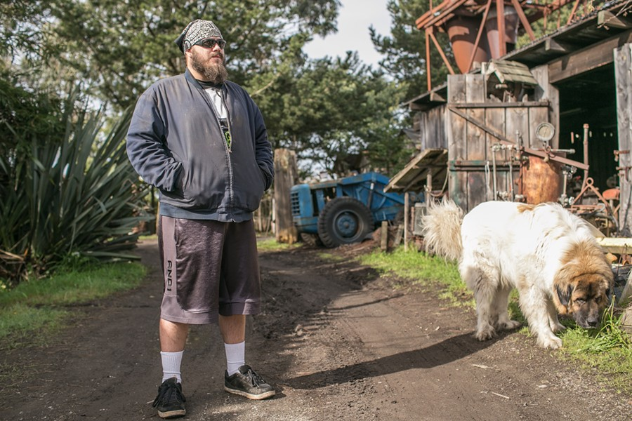 Cody Drury, an Army veteran, with Bluto. Drury served from 2002 to 2004 in the mortar infantry. He helped build the Lincoln hearse and became skilled at Blue Ox in numerous trades. He says Blue Ox is his sanctuary. - PHOTO BY ALEXANDER WOODARD