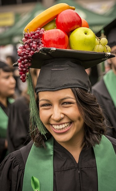 Communication major Ana Luisa Chavez wore her Carmen Miranda-like fruit-laden mortarboard hat. - MARK LARSON