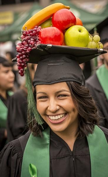 Communication major Ana Luisa Chavez wore her Carmen Miranda-like fruit-laden mortarboard hat. - MARK LARSON