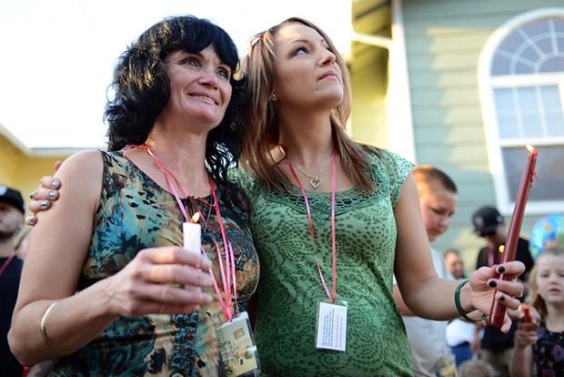 Corinna Ward and Patsy Yazzolino comfort each other. - MARK MCKENNA