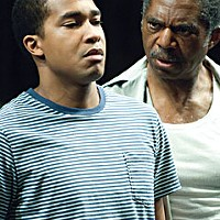 Cory (Cameron Knight, left) gets a stern lecture from his father Troy (Charles Robinson) in the Oregon Shakespeare Festival production of August Wilson's Fences. Photo by Jenny Graham.