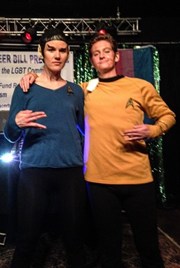 Costume contest winner Spock and Drag War runner-up James T. Kirk throw their signs. - JENNIFER FUMIKO CAHILL