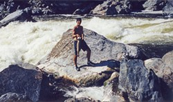 PHOTO COURTESY OF CRISPEN MCALLISTER - Crispen McAllister, 15, stands at Ishi Pishi Falls near Somes Bar. He says he plucked that fish out of the pool by his feet with his hands.