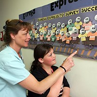 'Immediate Jeopardy' Director of Nurses Sherry Gallagher and her daughter, Austynn, point to a display on the wall of Eureka Healthcare and Rehabilitation.  Photo by Carol Harrison
