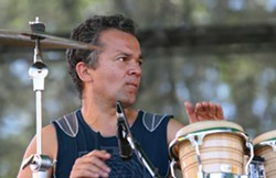 PHOTO BY BOB DORAN - Earthdance Founder Chris Dekker plays with his band Medicine Drum at Reggae Rising 2009.