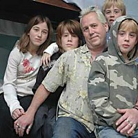 The guardian angel Eric Albertson and his children (L to R) Ivy, Zeb, Zeke and Seth. Albertson is the father of 10 children. they arrived at the MAC in mid-February and have plans of moving into section 8 housing by the end of next month. Photo by Katie O'Neill.