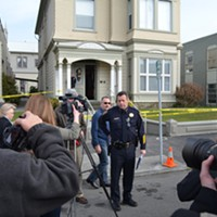 Eureka Police Chief Andy Mills addresses a crowd gathered in front of the crime scene.
